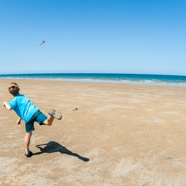 """Boy Boomerang Beach"" stock image"