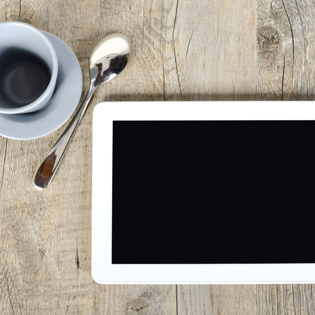 """""""digital tablet with a cup of coffee"""" stock image"""