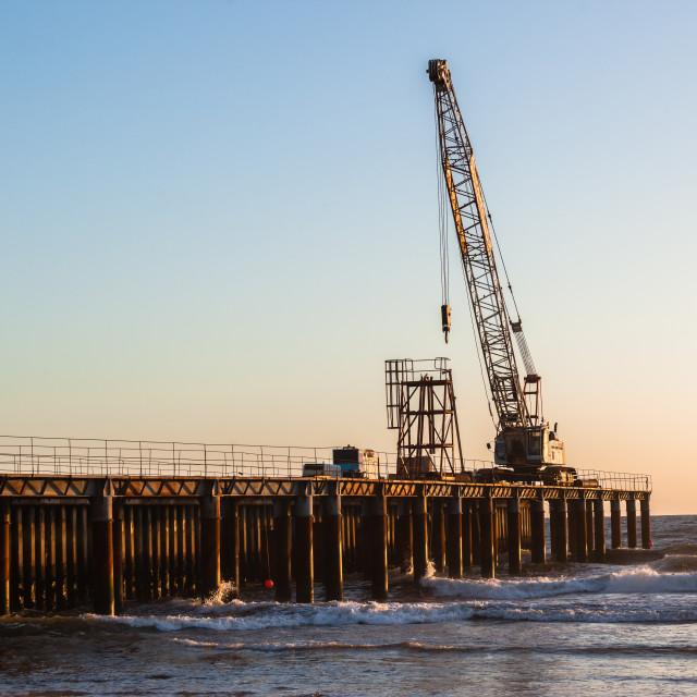 """Construction Beach Pier Crane"" stock image"