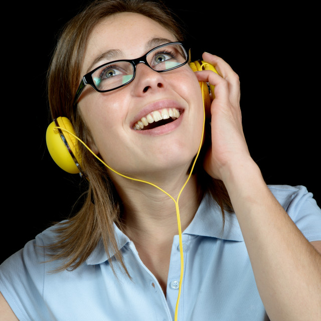 """pretty woman listening to music with a headphone"" stock image"