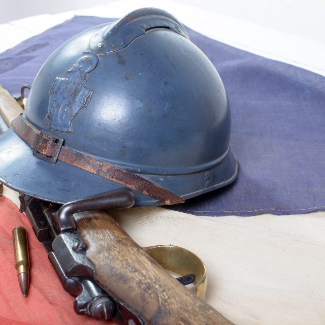 """french helmet of the First World War with a gun on french flag"" stock image"