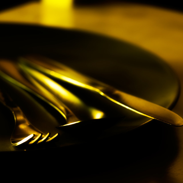 """Silverware in golden light"" stock image"