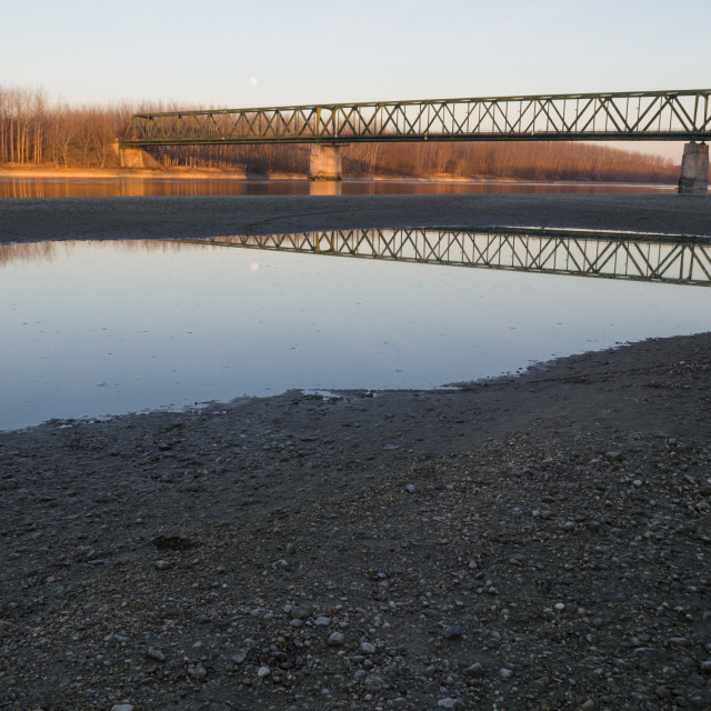 """VAMOSSZABADI, HUNGARY - FEBRUARY 13, 2014: The Vamosszabadi Bridge over Danube River in time of Low Water Level"" stock image"