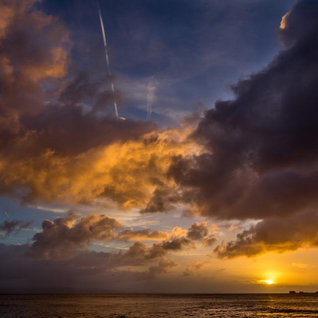 """Sunrise over the Mumbles"" stock image"