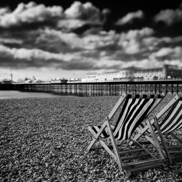 """Deck Chairs and Brighton Pier"" stock image"