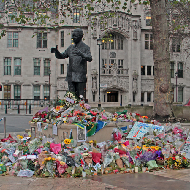 """Flowers for Nelson Mandela at his statue in London"" stock image"