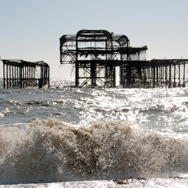 """Ruins of Brighton West Pier on stormy day"" stock image"