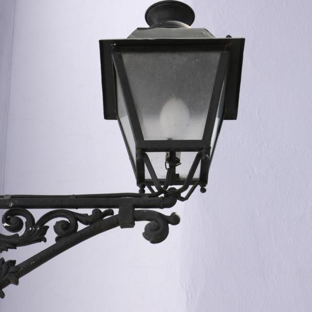 """Ornate Wall Mounted Lamp."" stock image"