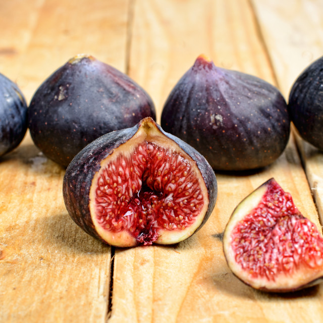 """figs placed on a wooden table"" stock image"