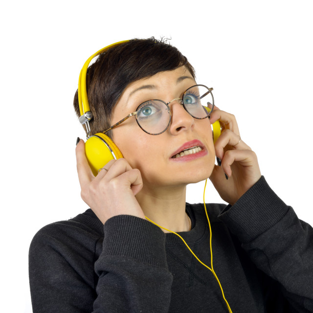 """""""Young Woman wearing headphones listening to music"""" stock image"""