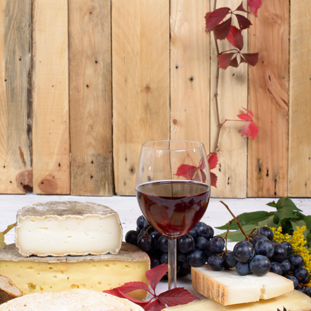 """""""french cheese platter with wine and grapes"""" stock image"""