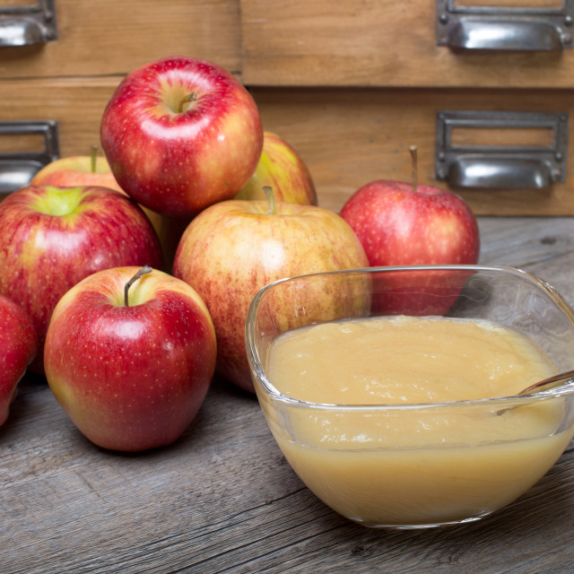 """Applesauce on a wooden table"" stock image"