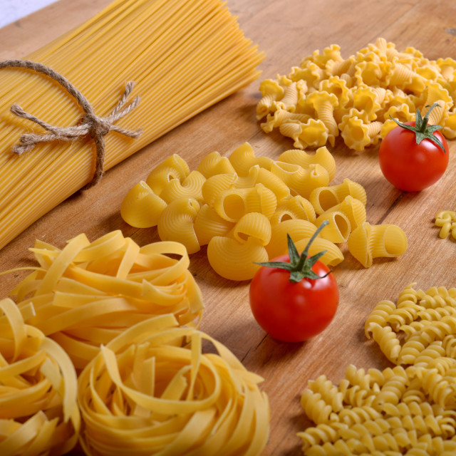 """Different pasta with tomatoes"" stock image"