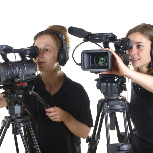 """""""two young women with video cameras"""" stock image"""