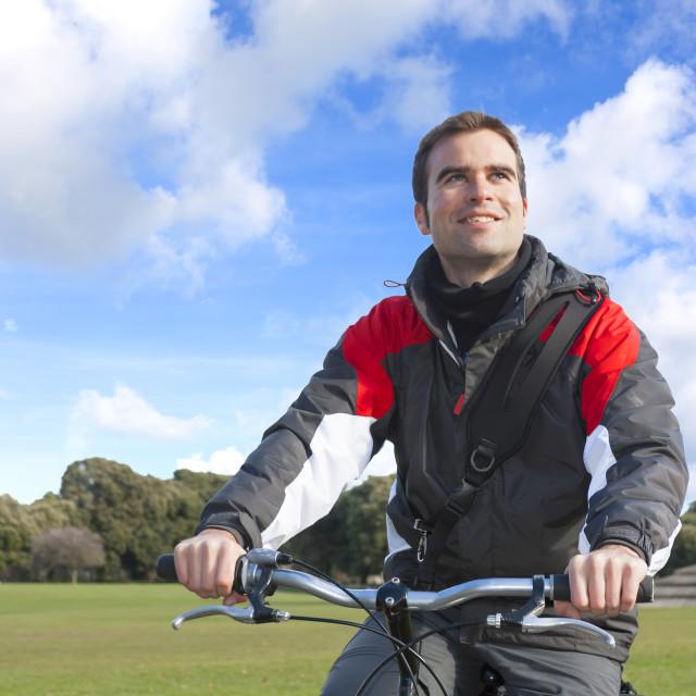 """Happy man cycling"" stock image"