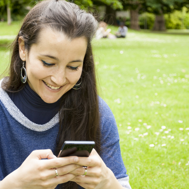 """Woman using mobile"" stock image"