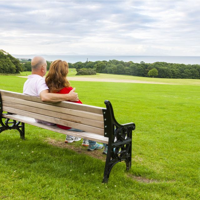 """""""Adult couple on the bench"""" stock image"""