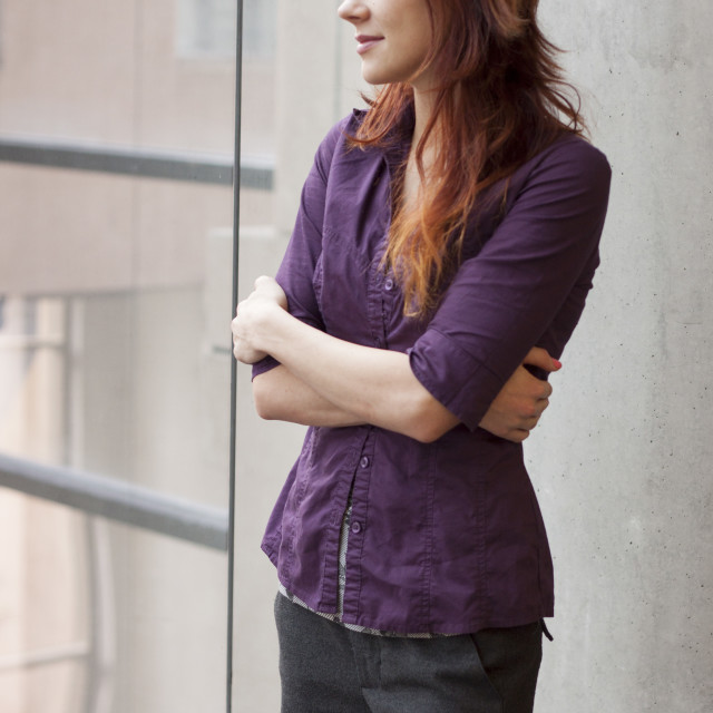 """""""businesswoman looking out window - on top of the world"""" stock image"""