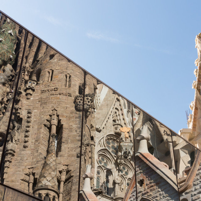 """Relefection of Sagrada Familia in modern glass window and Sky"" stock image"