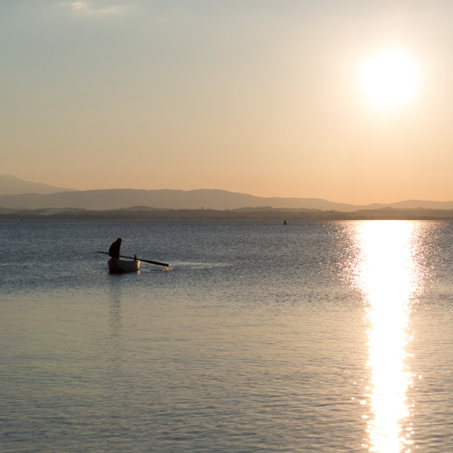 """Fisherman on the Lake at Dusk"" stock image"