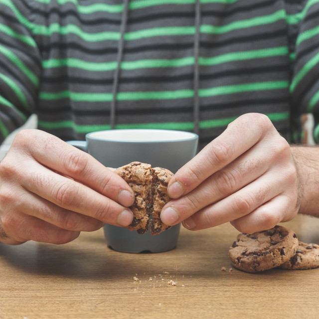 """Man having breakfast at home. Milk and cookies"" stock image"