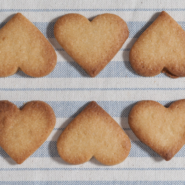 """Butter cookies, heart shaped, on a striped fabric napkin"" stock image"