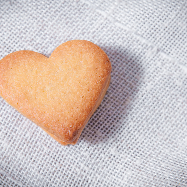 """Butter cookies, heart shaped, on a white fabric napkin"" stock image"