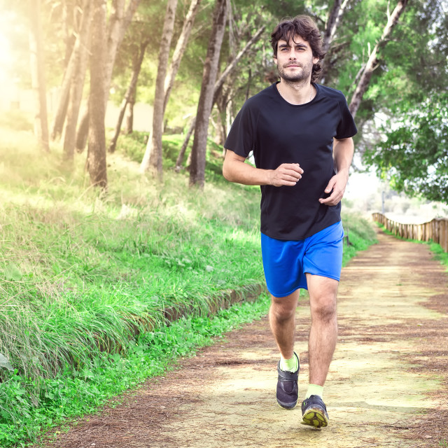 """Man running in the park"" stock image"