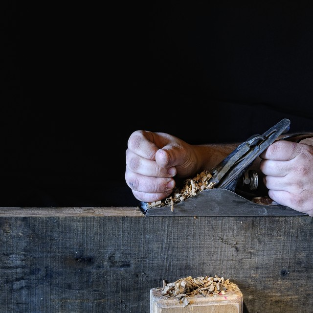 """Carpenter working with a planer"" stock image"