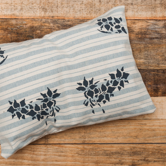 """Handmade cushion, painted, on wooden background"" stock image"