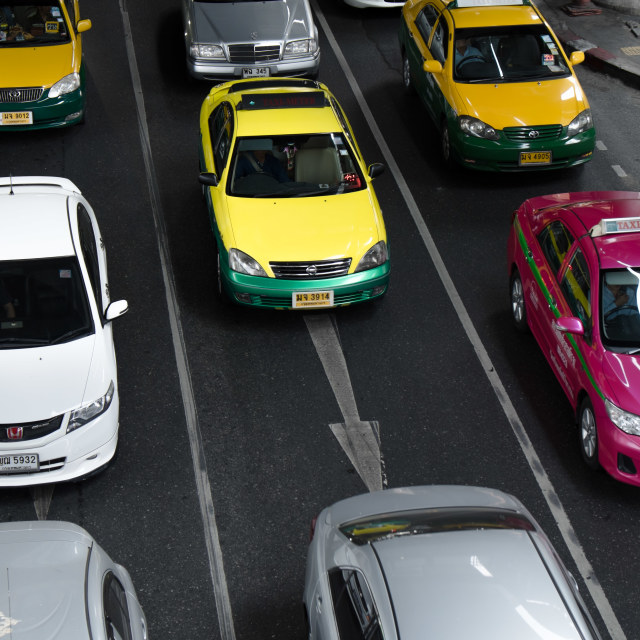 """BANGKOK, THAILAND - 14 FEBURARY 2014: Taxis make up more than half of vehicles on the road in Bangkok. It is the major cause of traffic jam."" stock image"