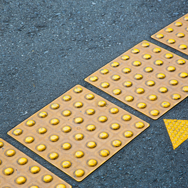 """Tactile paving in a train station"" stock image"