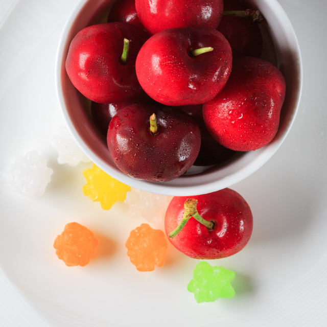 """Cherry on saucer with konpeito"" stock image"