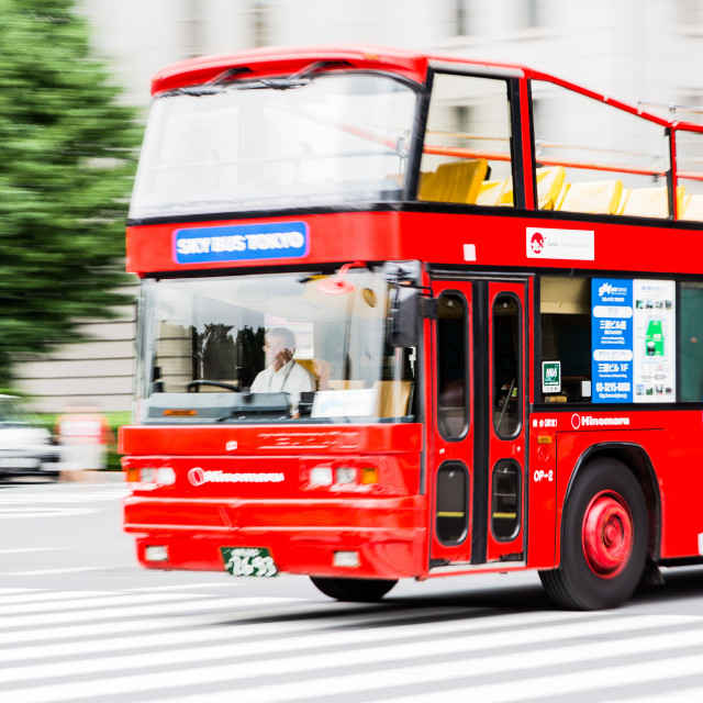 """TOKYO - CIRCA JULY 2014: Tokyo Sky Bus, operated by Hinomaru Jidosha Kogyo. It is the first open roof tour bus in Tokyo"" stock image"