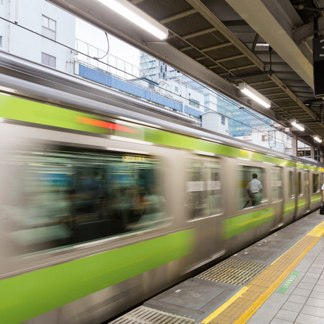 """TOKYO, JAPAN - CIRCA JULY, 2014: JR Commutor trains are the main mode of transportation in Tokyo. JR is owned by the government of tokyo."" stock image"