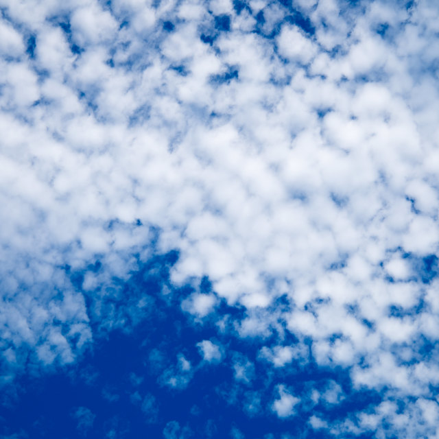 """""""Small clouds over the sky"""" stock image"""