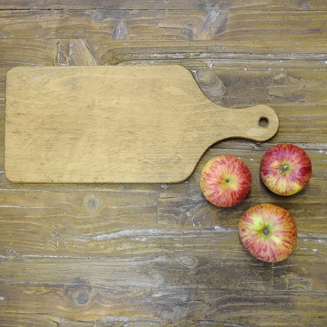 """Cutting board with three apples."" stock image"