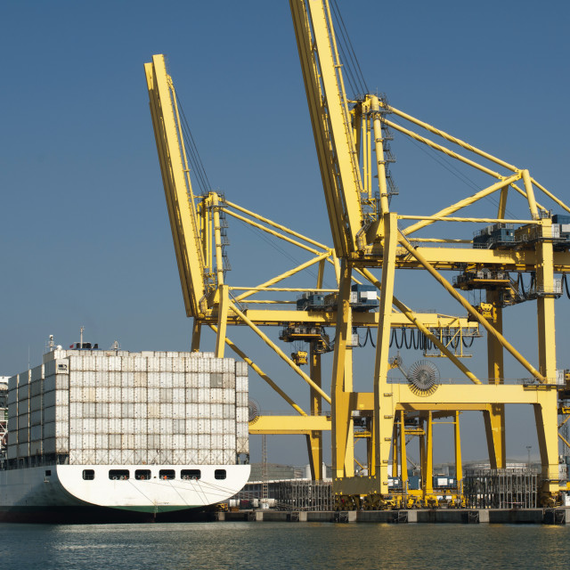 """""""Freighter in port being loaded with containers"""" stock image"""