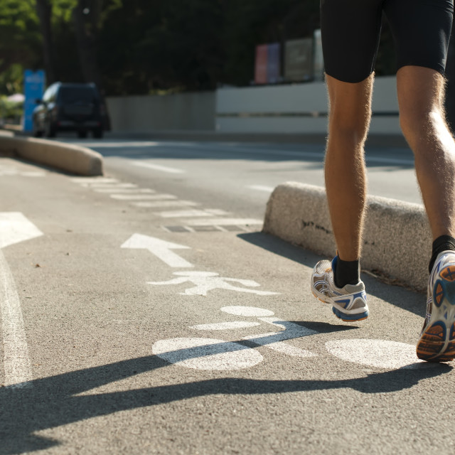 """Human feets in sportshoes running"" stock image"