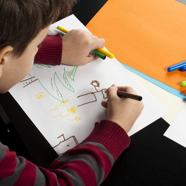"""Boy drawing with markers"" stock image"