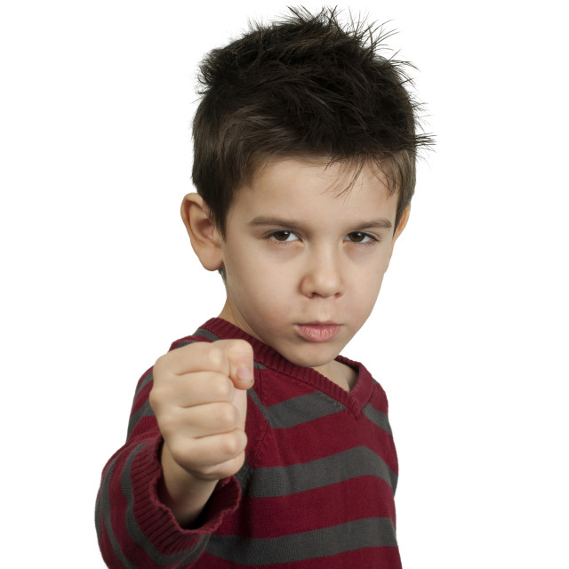 """Little boy threatens with a fist to fight"" stock image"