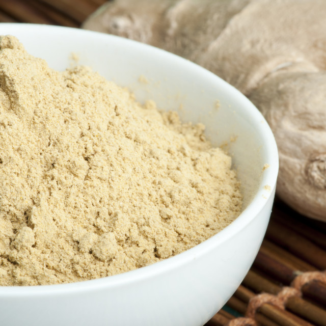 """Powdered ginger in a bowl and whole ginger"" stock image"
