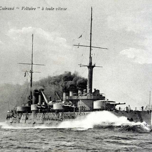 """old postcard voltaire the battleship at full speed"" stock image"