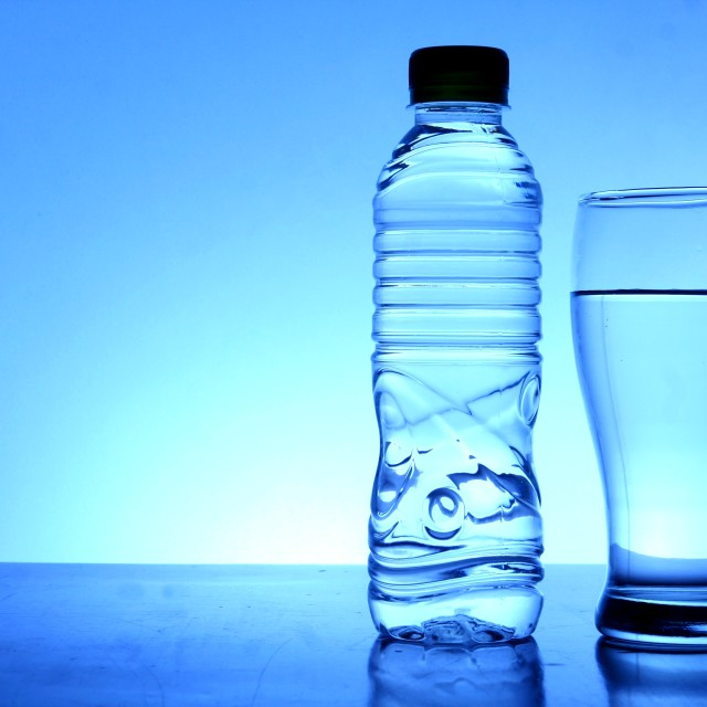 """Bottle and glass of water"" stock image"