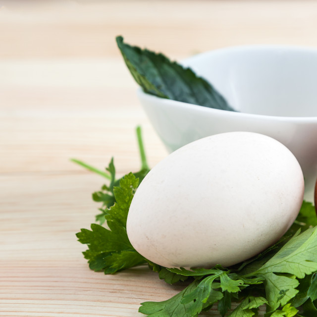 """Eggs of different types with parsley"" stock image"