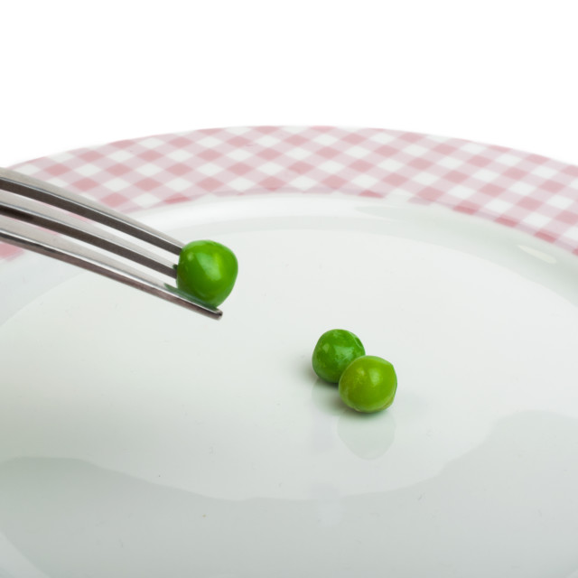 """Plate with peas and centimeter measure"" stock image"