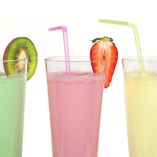 """Banana, kiwi and strawberry milk shake and fresh fruis"" stock image"