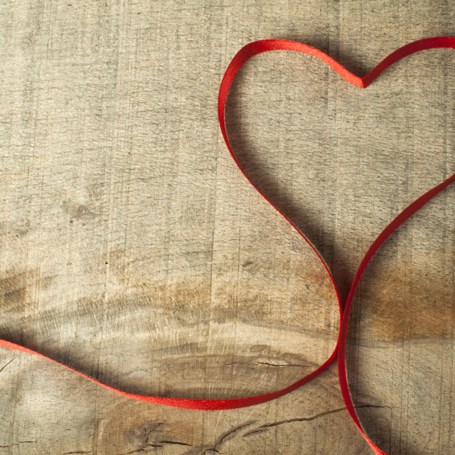 """Red ribbon heart on wooden background"" stock image"