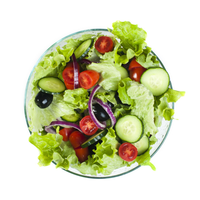 """Salad in a glass bowl on a white background"" stock image"