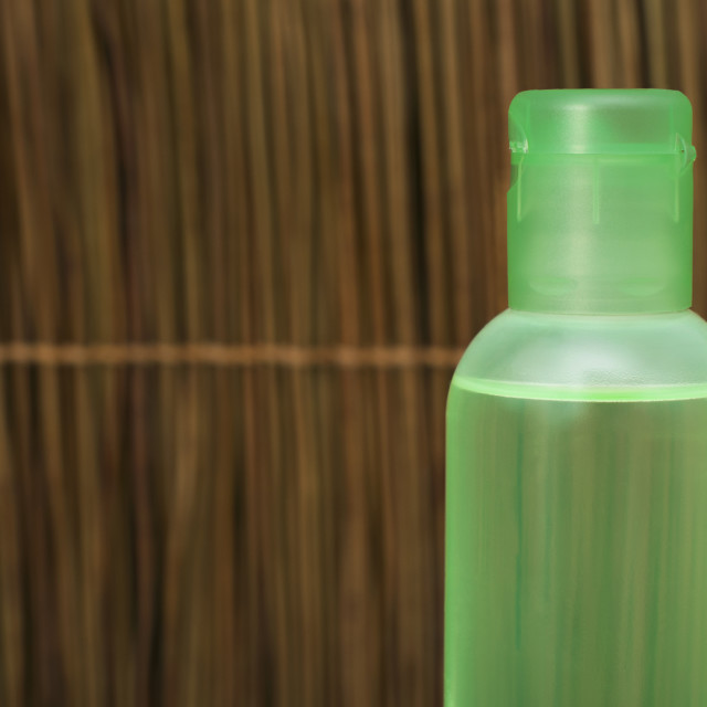 """Green transparent cosmetic bottle"" stock image"